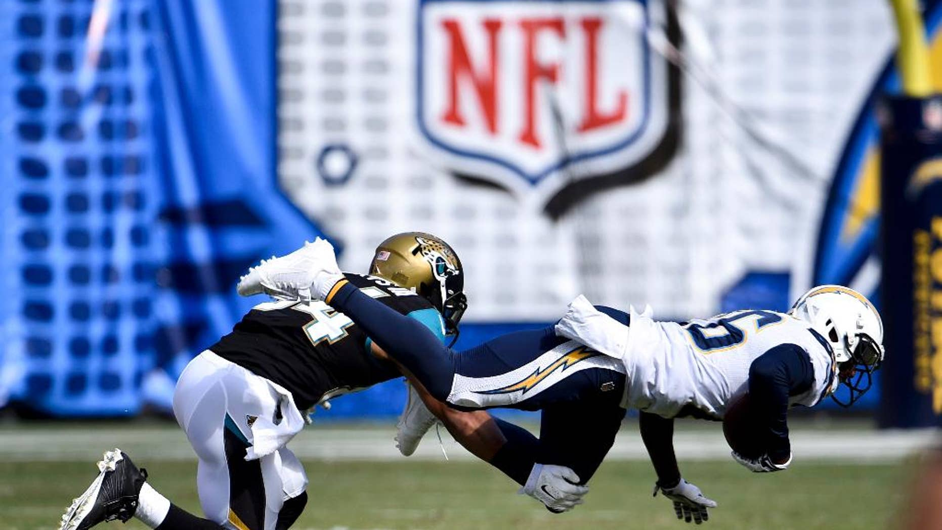 San Diego Chargers cornerback Brandon Flowers intercepts a pass in front of Jacksonville Jaguars wide receiver Cecil Shorts during the second half of an NFL football game Sunday, Sept. 28, 2014, in San Diego. (AP Photo/Denis Poroy)