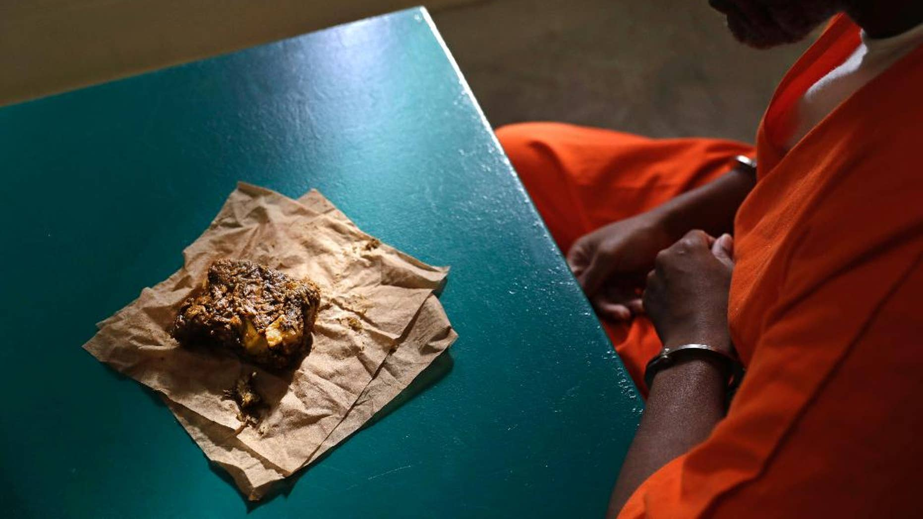 Oct. 26, 2016: A nutraloaf, a meal typically given to inmates for misbehavior involving food or bodily waste, sits in front of inmate Kevin Dickens during an interview with The Associated Press at James T. Vaughn Correctional Center in Smyrna, Del.
