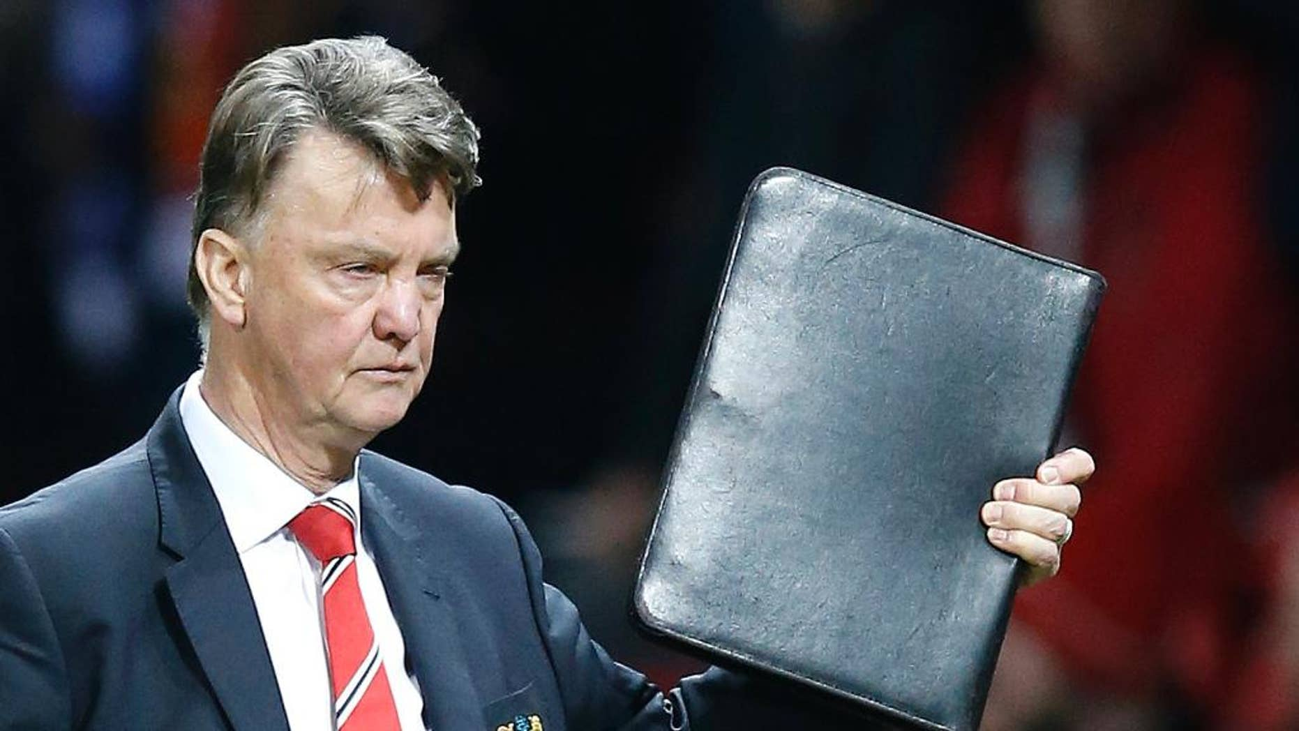 Manchester United's manager Louis van Gaal leaves at the end of the English Premier League soccer match between Manchester United and Chelsea at Old Trafford Stadium, Manchester, England, Monday, Dec. 28, 2015. (AP Photo/Jon Super)