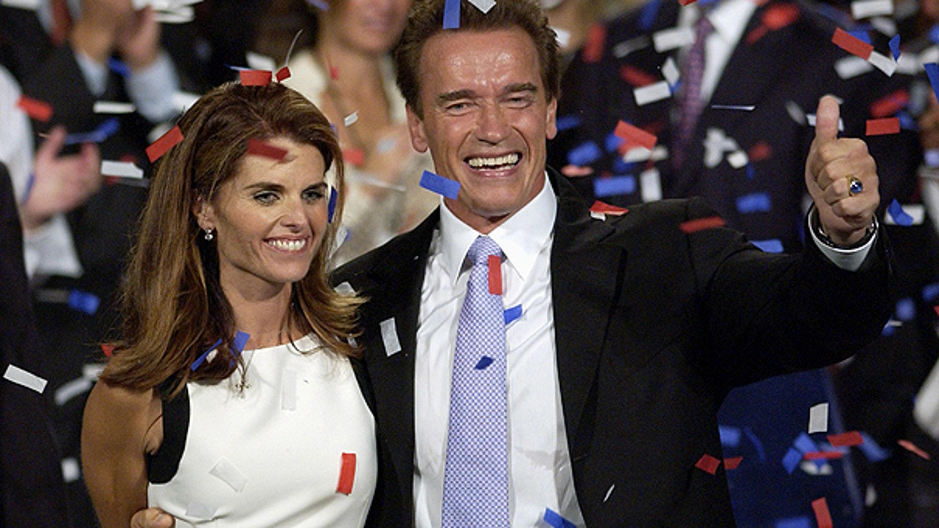In this file photo taken Oct. 7, 2003, shows Arnold Schwarzenegger and his wife, Maria Shriver ,as they celebrate his victory in the California gubernatorial recall election in Los Angeles.