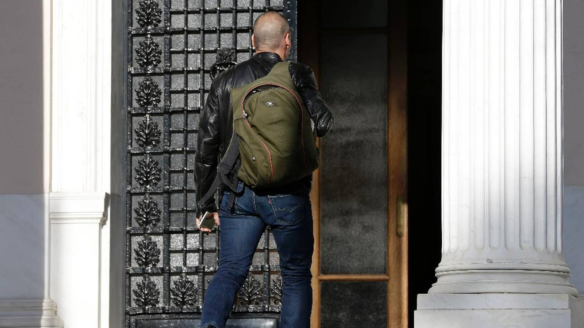Greece's Finance Minister Yanis Varoufakis arrives for a ministerial meeting at Maximos Mansion in Athens, Wednesday, May 13, 2015. Greece's prime minister Alexis Tsipras was holding his second ministerial meeting in as many days Wednesday, when official data confirmed the cash-strapped country is back in recession amid concern over much-delayed bailout talks with creditors. (AP Photo/Thanassis Stavrakis)