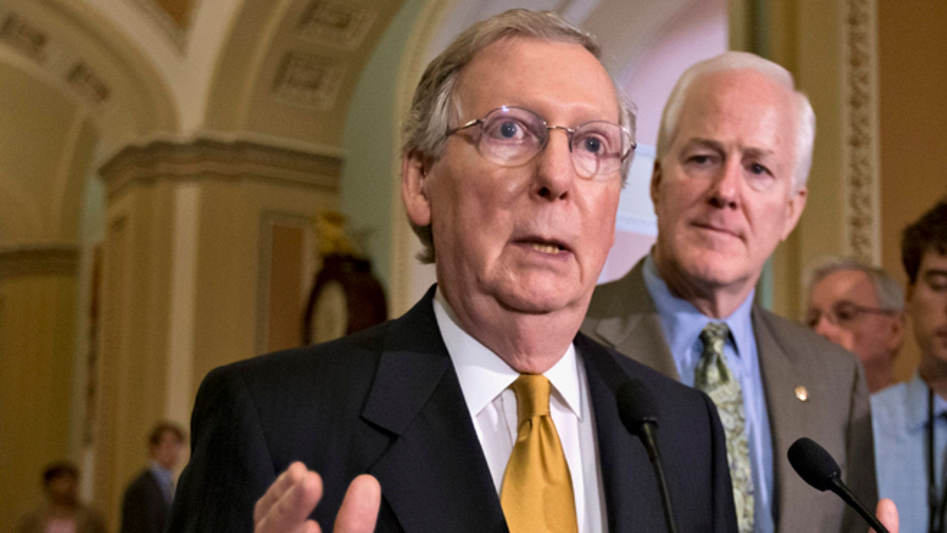 FILE: June 11, 2013: Then-Senate Minority Leader Mitch McConnell, R- Ky., left, and Minority Whip John Cornyn, R-Texas, speak with reporters on Capitol Hill, in Washington, D.C.
