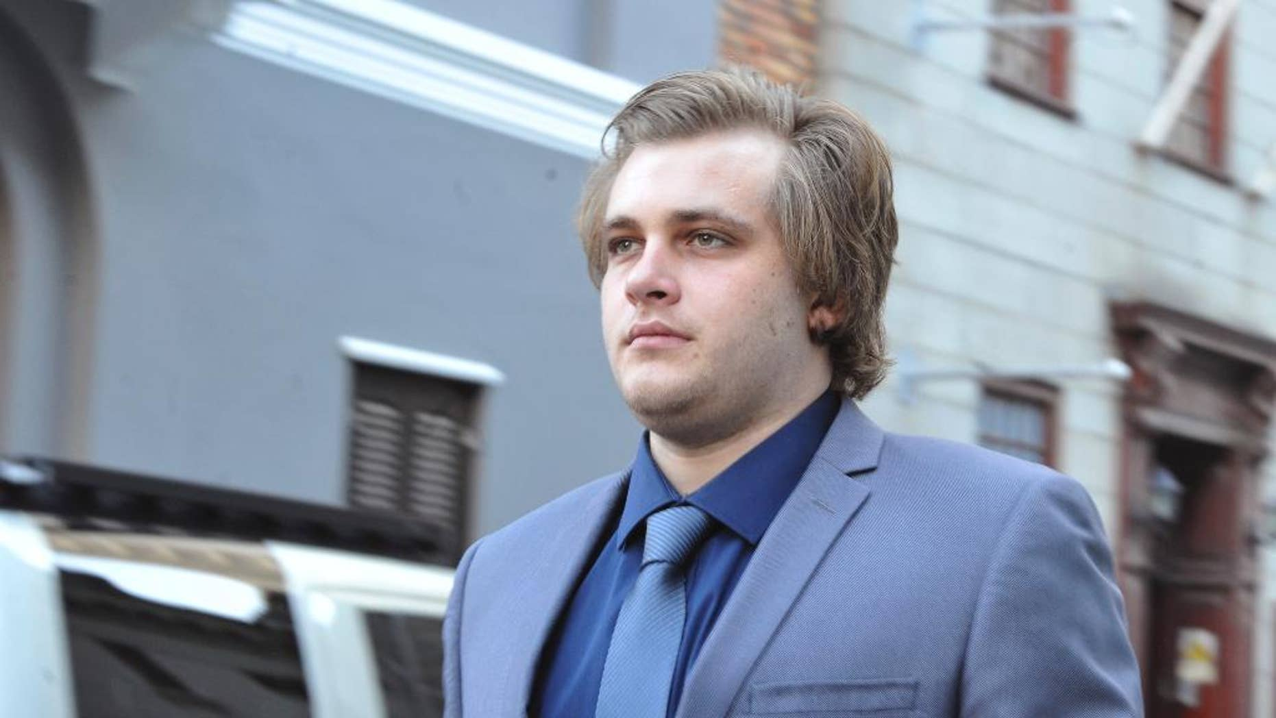 Henri Van Breda arrives at the High Court in Cape Town, South Africa, Monday, April 24, 2017. He is accused of murder of his parents and older brother in 2015. Breda pleaded not guilty to murder and to the attempted murder of his sister with an axe. (AP Photo)