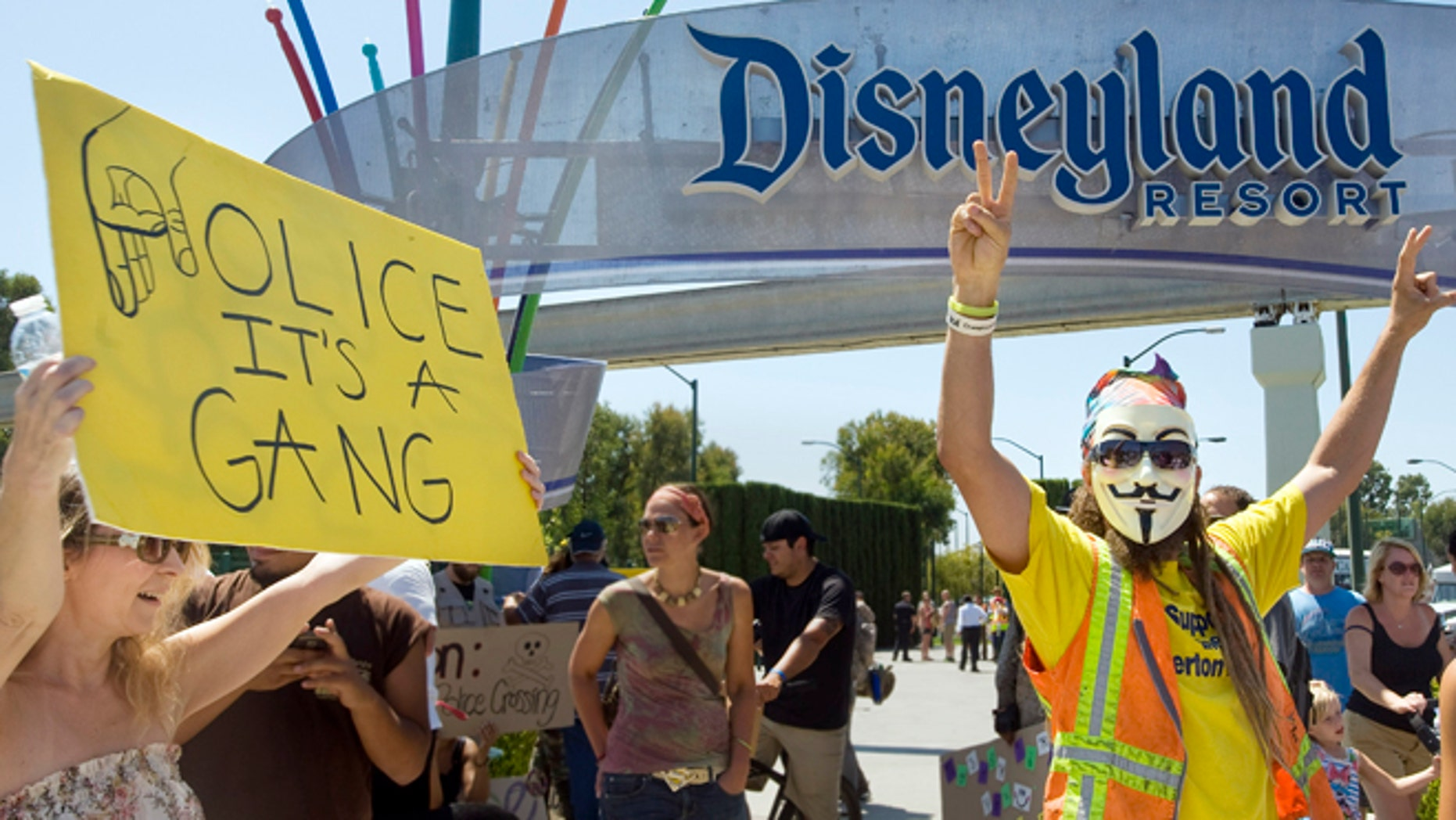 FILE - In this Aug. 5, 2012 file photo, protesters rally outside Disneyland in Anaheim, Calif., protesting what they say is excessive police force used by Anaheim police. Ferguson, Mo., has become an emblem of the tensions between minorities and police departments nationwide since Darren Wilson, a white officer, shot and killed Michael Brown, an unarmed black teenager, last summer. A U.S. Justice Department report released the first week of March, 2015, cleared Wilson of criminal wrongdoing. Though the study centered on Ferguson, its findings have resonated nationwide as residents in some communities across the country say they feel they face the same struggles with their police departments and city leadership. (AP Photo/The Orange County Register, Mindy Schauer, File)
