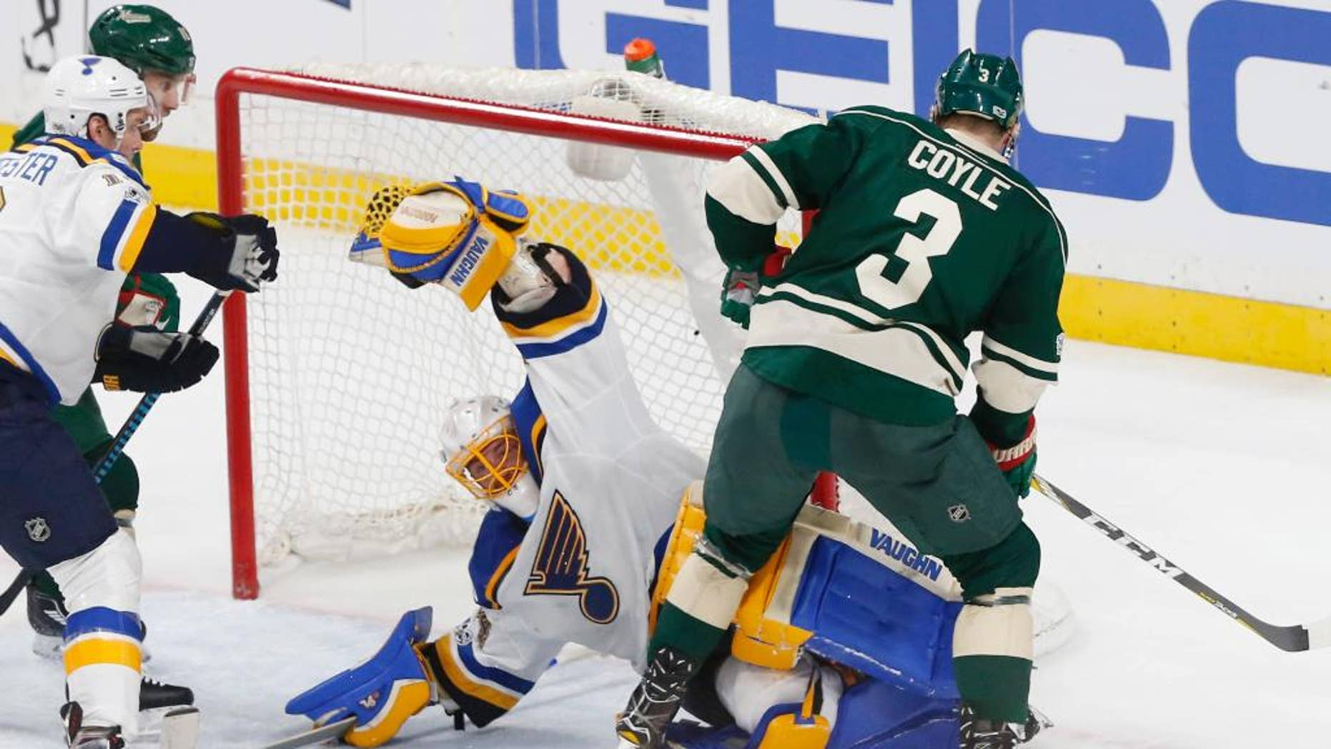 St. Louis Blues goalie Jake Allen stops a shot by Minnesota Wild's Charlie Coyle, right, during the second period of Game 1 of an NHL hockey first-round playoff series Wednesday, April 12, 2017, in St. Paul, Minn. (AP Photo/Jim Mone)