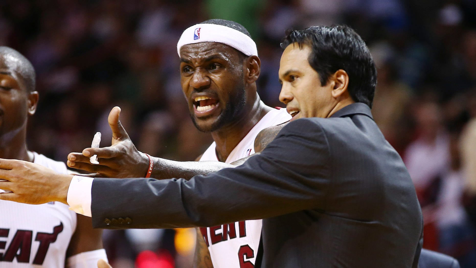 Miami Heat coach Erik Spoelstra, right, and LeBron James protest a loose ball foul called against James during the second half of an NBA basketball game against the Los Angeles Clippers in Miami, Thursday, Nov. 7, 2013. The Heat won 102-97. (AP Photo/J Pat Carter)
