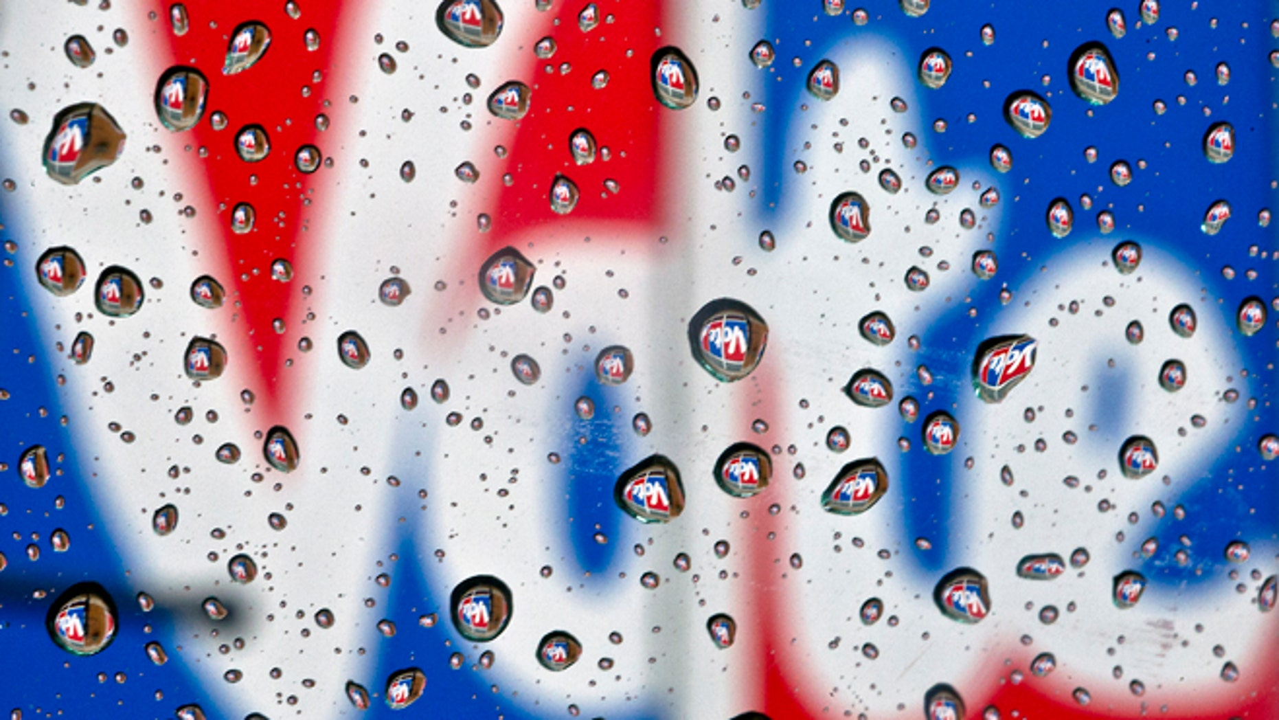 The word Vote, part of a mural to encourage voting, is reflected in raindrops in Danville, Ky., on Monday, Oct. 1, 2012. President Barack Obama and Republican challenger Mitt Romney are hunkered down Monday, practicing for their first debate to take place in Denver on Wednesday, Oct. 3. (AP Photo/The Advocate Messenger, Clay Jackson)