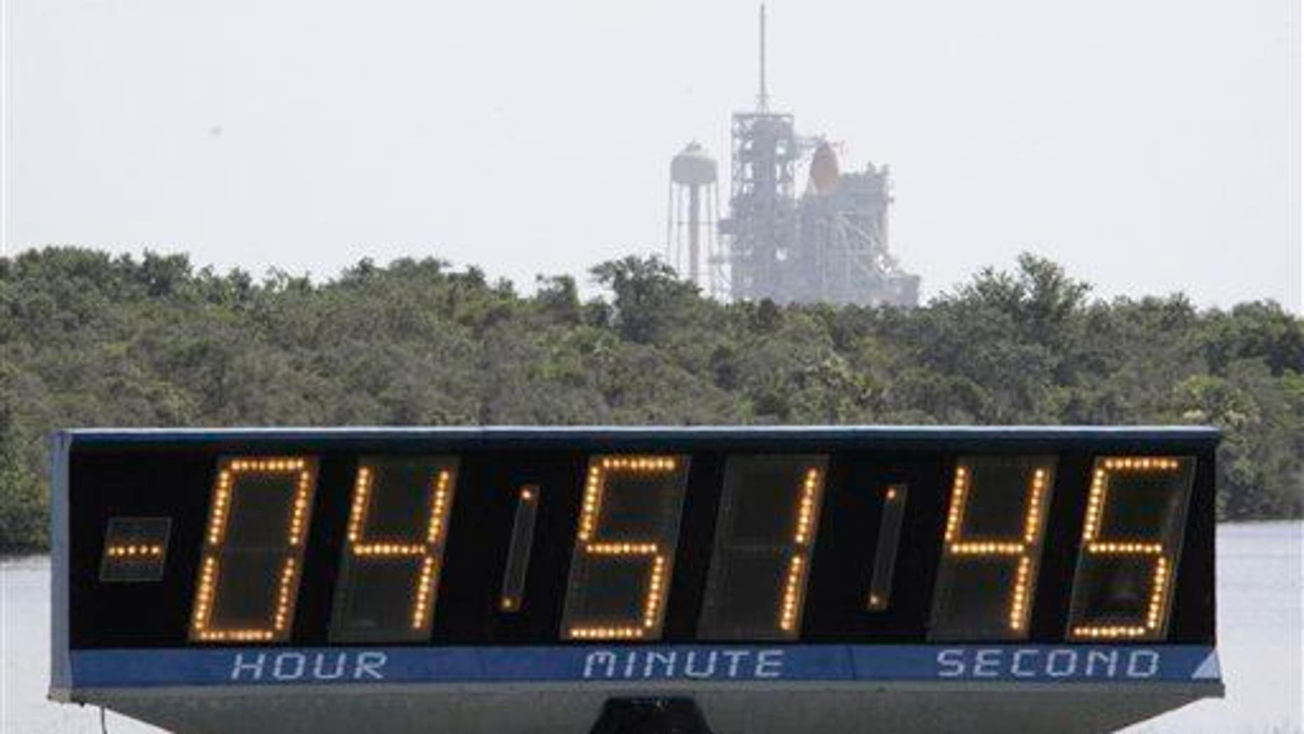 The countdown clock continues to click as the space shuttle Endeavour sits at the Kennedy Space Center at Cape Canaveral, Fla., on July 12, 2009.