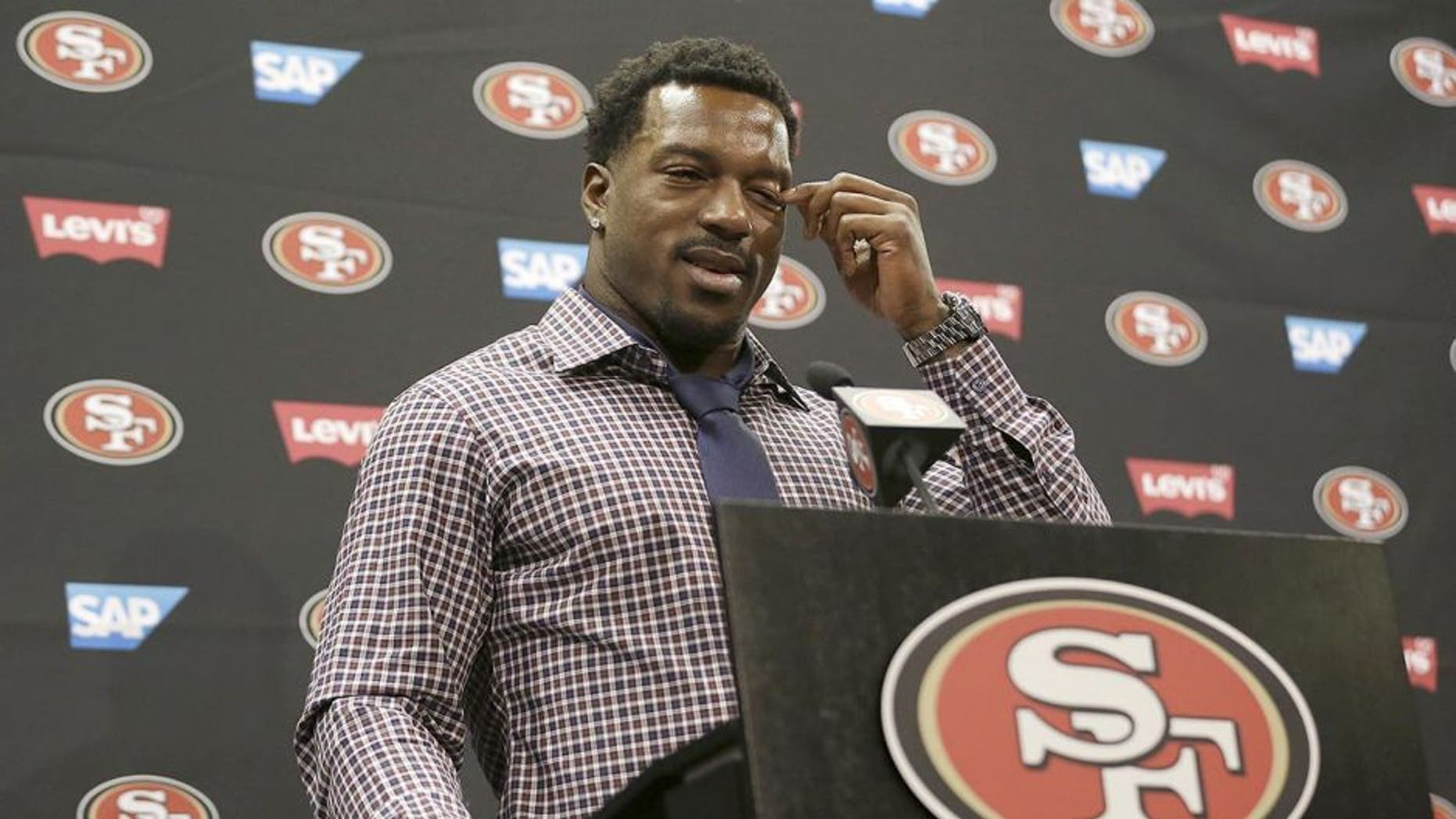San Francisco 49ers linebacker Patrick Willis wipes his eye as he speaks at a news conference at the team's NFL football facility in Santa Clara, Tuesday, March 10, 2015. Willis, a seven-time Pro Bowler, will retire after his 2014 season was cut short by a toe injury that required surgery. (AP Photo/Jeff Chiu)