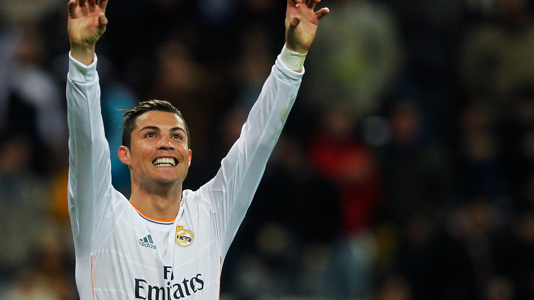 FILE - The Jan. 6, 2013 file photo shows Real Madrid's Cristiano Ronaldo from Portugal celebrating his goal during a Spanish La Liga soccer match between Real Madrid and Celta at the Santiago Bernabeu stadium in Madrid. Ronaldo is one of the three candidates as the world's best soccer player  to be awarded at the FIFA Ballon d'Or gala on Monday, Jan 13, 2014. (AP Photo/Andres Kudacki)