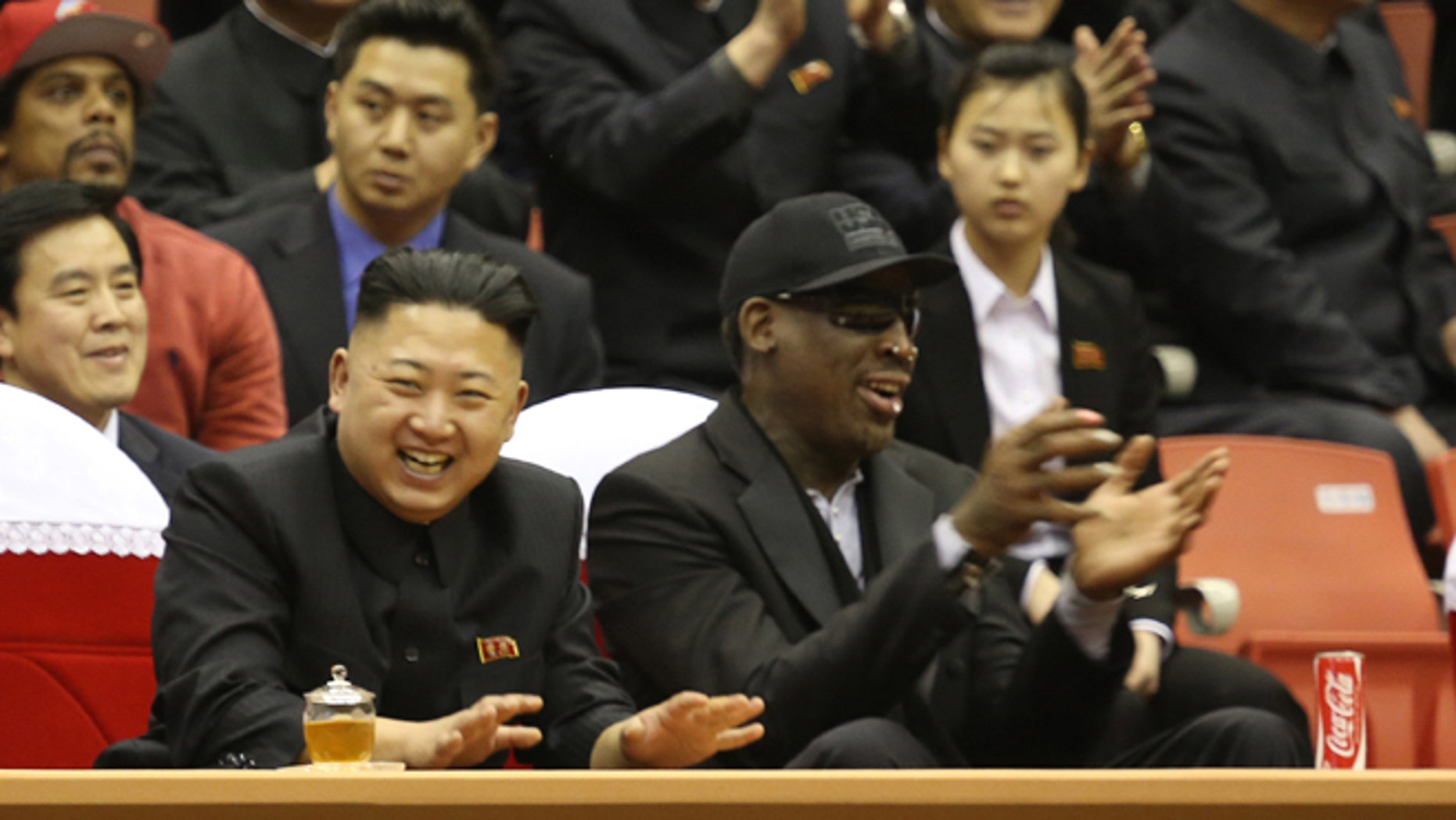 Feb. 28, 2013: North Korean leader Kim Jong Un, left, and former NBA star Dennis Rodman watch North Korean and U.S. players in an exhibition basketball game at an arena in Pyongyang, North Korea.