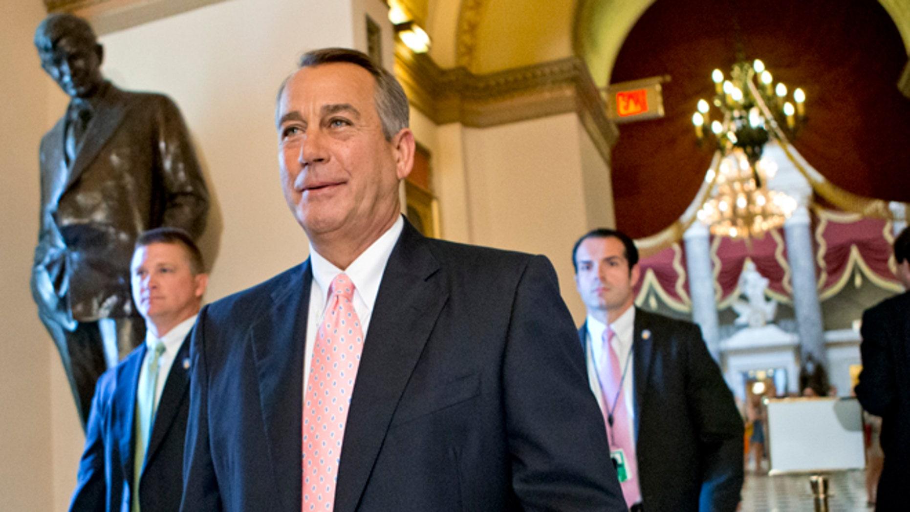 FILE: July 19, 2013: House Speaker John Boehner walks to the chamber floor on Capitol Hill, in Washington, D.C.