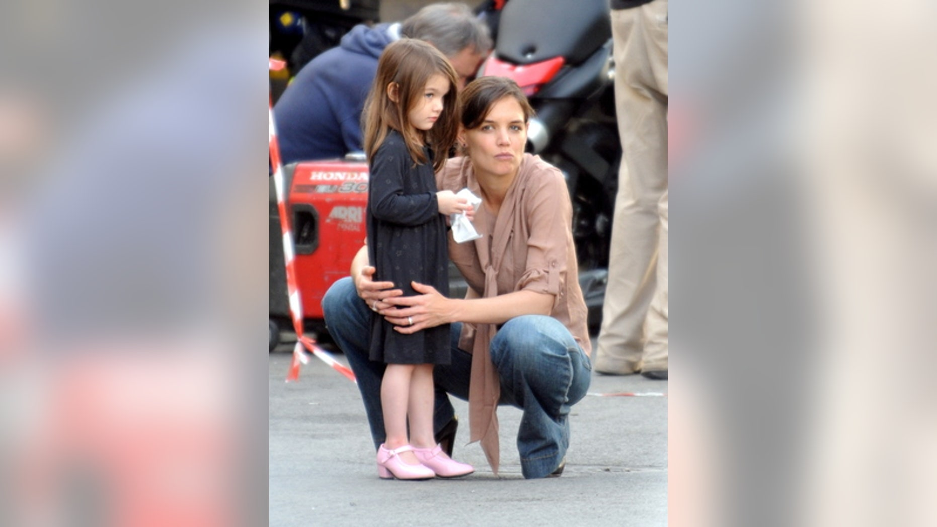 "Katie Holmes and Suri Cruise watching Tom Cruise and Cameron Diaz on the set of ""Knight and Day"" in December 2009."