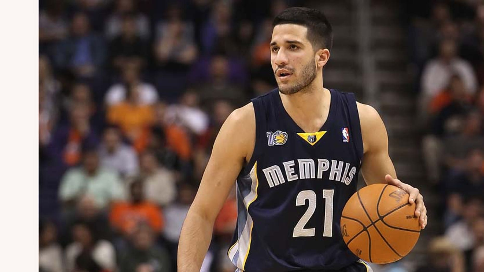 PHOENIX - DECEMBER 08:  Greivis Vasquez #21 of the Memphis Grizzlies handles the ball against the Phoenix Suns during the NBA game at US Airways Center on December 8, 2010 in Phoenix, Arizona. NOTE TO USER: User expressly acknowledges and agrees that, by downloading and or using this photograph, User is consenting to the terms and conditions of the Getty Images License Agreement.  (Photo by Christian Petersen/Getty Images)