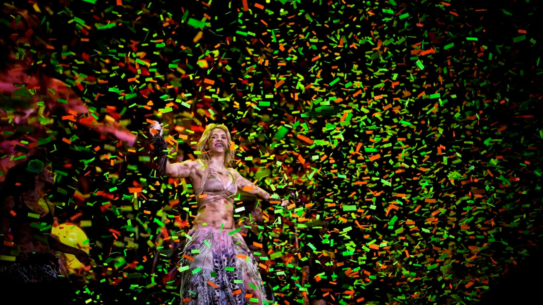 """Colombia's star singer Shakira performs during """"The Sun Comes Out World Tour"""" concert in Barcelona, Spain, Sunday night, May 29, 2011. (AP Photo/Emilio Morenatti)"""