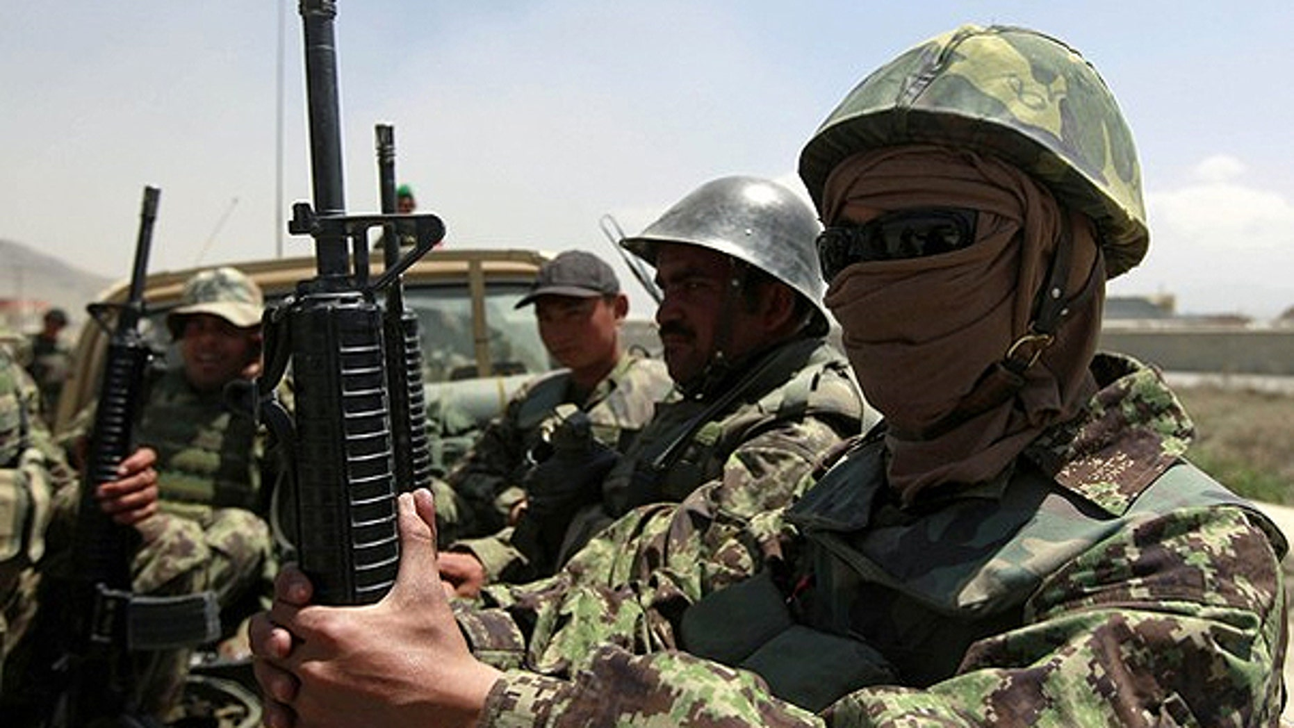 April 27: Afghan National Army (ANA) soldiers arrive at the gate of the Afghan air force compound in Kabul.