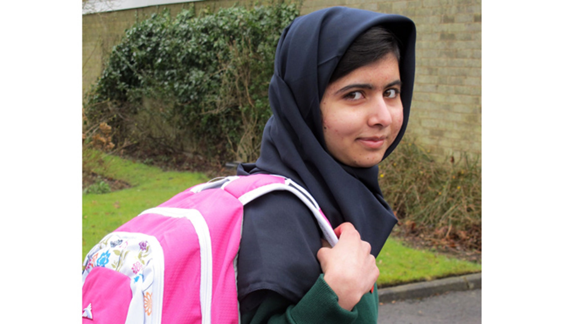 Image made available by her press office of Malala Yousafzai, the Pakistani schoolgirl shot in the head by the Taliban, as she attends her first day of school on Tuesday March 19, 2013 just weeks after being released from hospital.