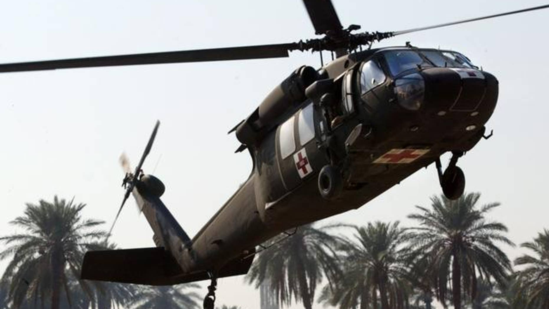 A U.S. Army Blackhawk medevac helicopter arrives with wounded soldiers at the 31st Combat Support Hospital in Baghdad, Iraq Tuesday, Nov. 9, 2004. (AP Photo/John Moore)