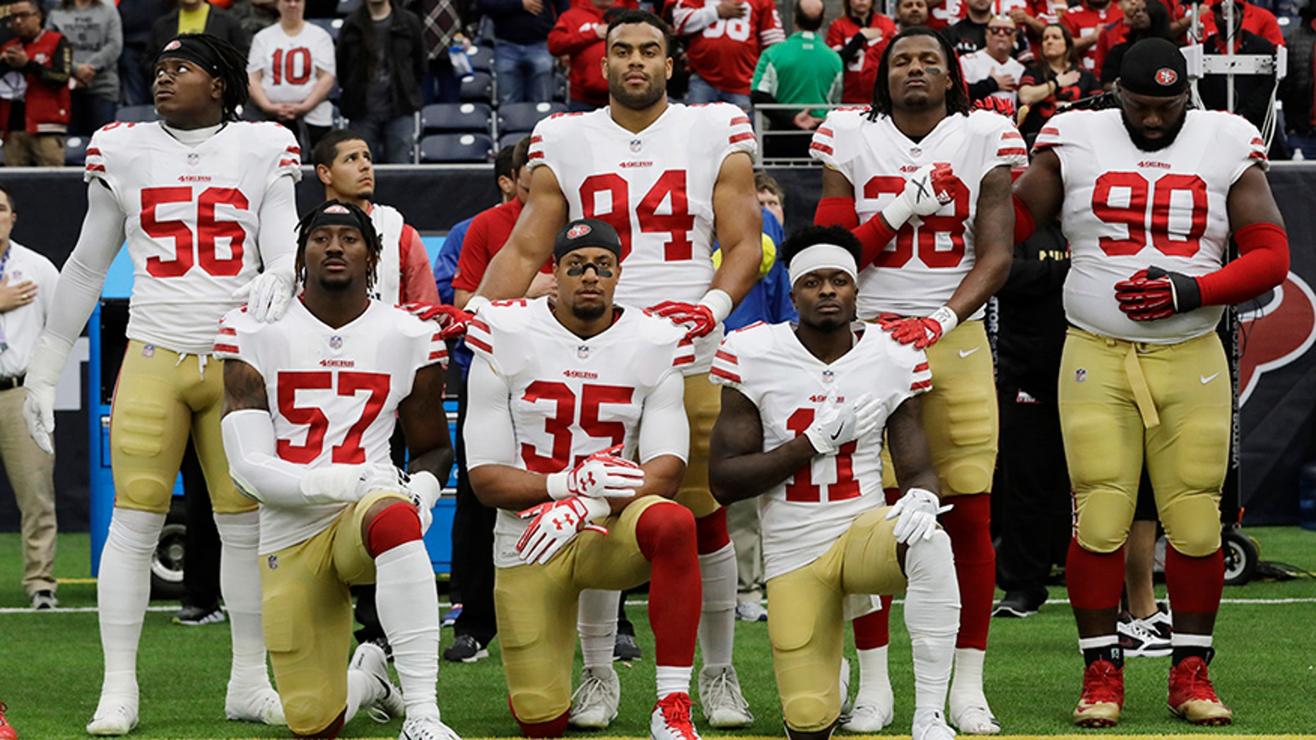 Dec. 10, 2017: San Francisco 49ers players kneel during the national anthem before an NFL football game against the Houston Texans.