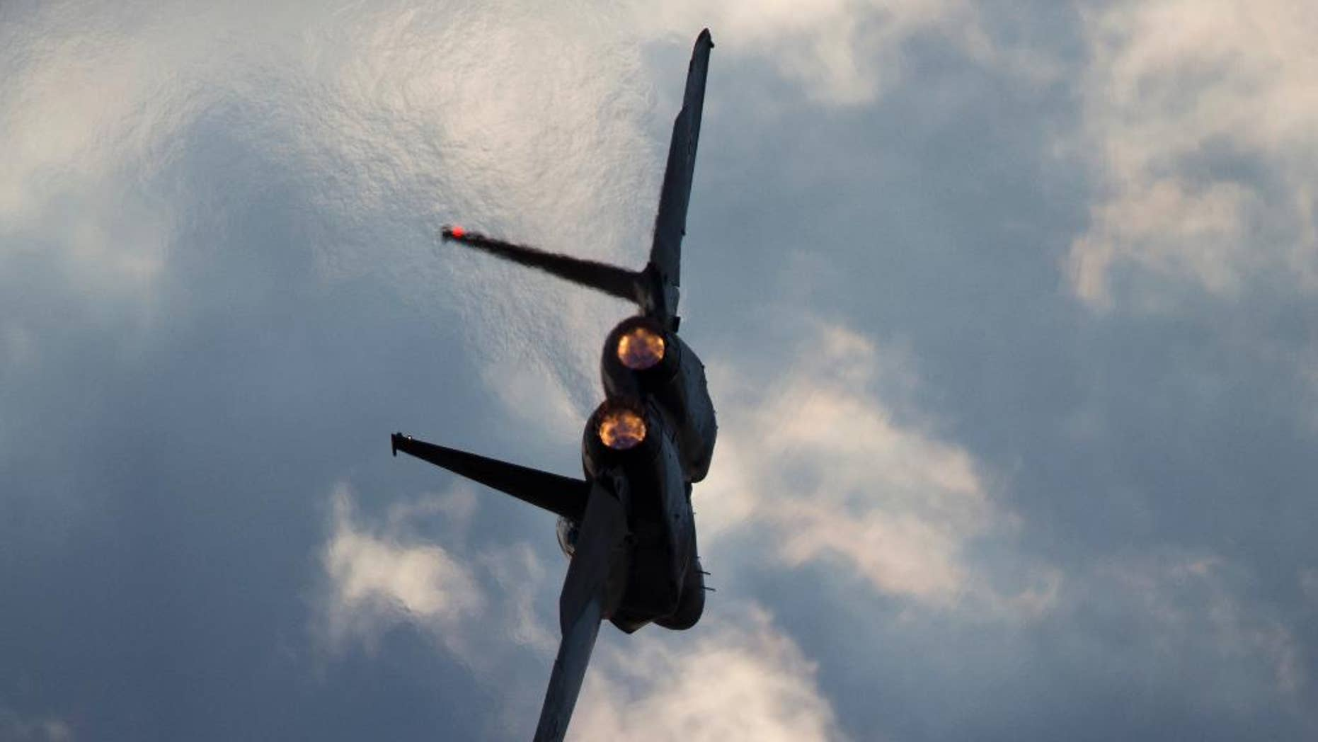 This Thursday, Dec. 29, 2016 photo shows an Israeli Air Force F-15 plane in flight during a graduation ceremony for new pilots in the Hatzerim air force base near the city of Beersheba, Israel. Anti-aircraft missiles were launched from Syria into Israeli-controlled territory early on Friday, following a series of Israeli airstrikes inside Syria, the Israeli military said. The military said its warplanes struck several targets in Syria and were back in Israeli-controlled airspace when several anti-aircraft missiles were launched from Syria toward the Israeli jets. (AP Photo/Ariel Schalit)