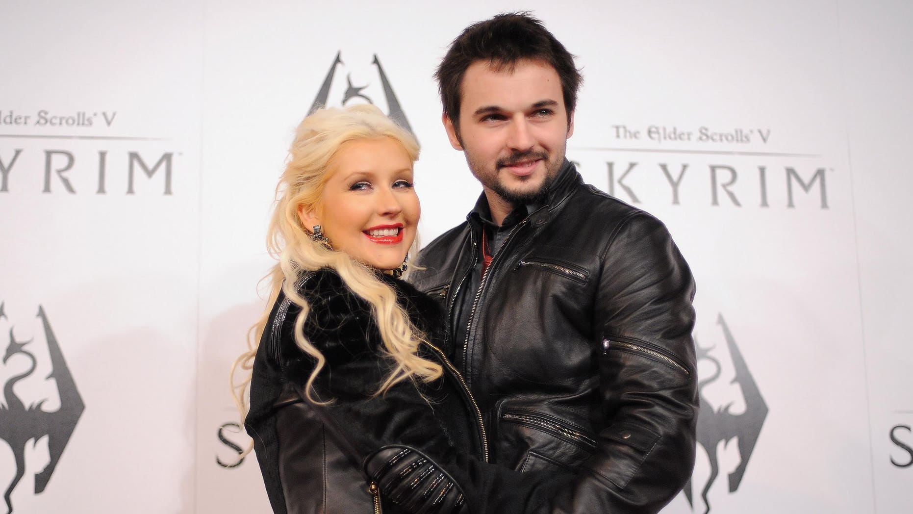 LOS ANGELES, CA - NOVEMBER 08:  Singer Christina Aguilera and Matt Rutler arrive at the official launch party for the most anticipated video game of the year, The Elder Scrolls V: Skyrim, at the Belasco Theatre on November 8, 2011 in Los Angeles, California.  (Photo by Jordan Strauss/Getty Images for Bethesda)