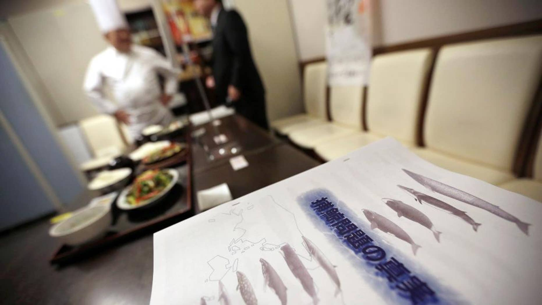 "FILE - In this Nov. 19, 2014 file photo, booklets titled ""The Truth of Whaling Problem"" are placed next to whale meat dishes on display at a cafeteria of Ministry of International Trade and Industry in Tokyo as it started to serve whale meat. Japan aims to resume whale hunts in the Antarctic later this year, even though the International Whaling Commission says Tokyo hasn't proven that the mammals need to be killed for research. The IWC's Scientific Committee said in a report Friday, June 19, 2015 that it wasn't able to determine whether lethal sampling is necessary for whale stock management and conservation. (AP Photo/Eugene Hoshiko, File)"