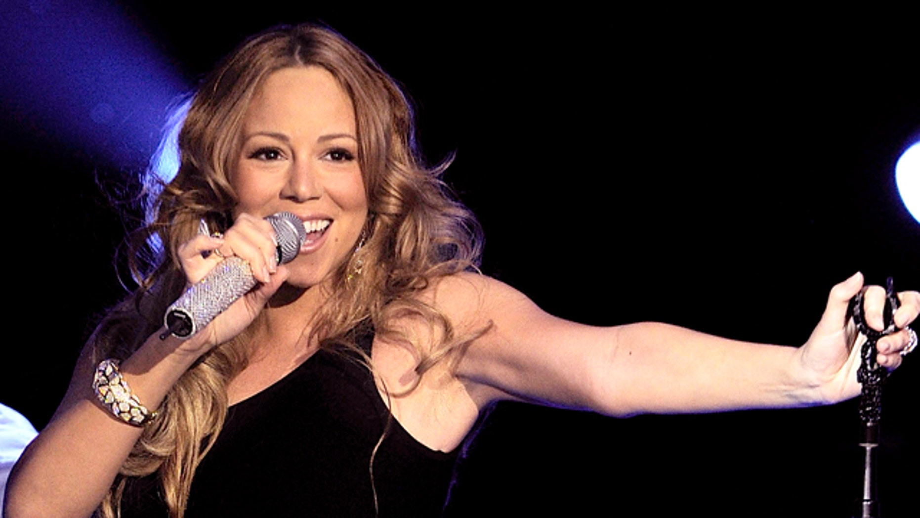 NEW YORK, NY - MARCH 01:  Mariah Carey performs during Escape To Total Rewards at Gotham Hall on March 1, 2012 in New York City.  (Photo by Larry Busacca/Getty Images for Caesars Entertainment)