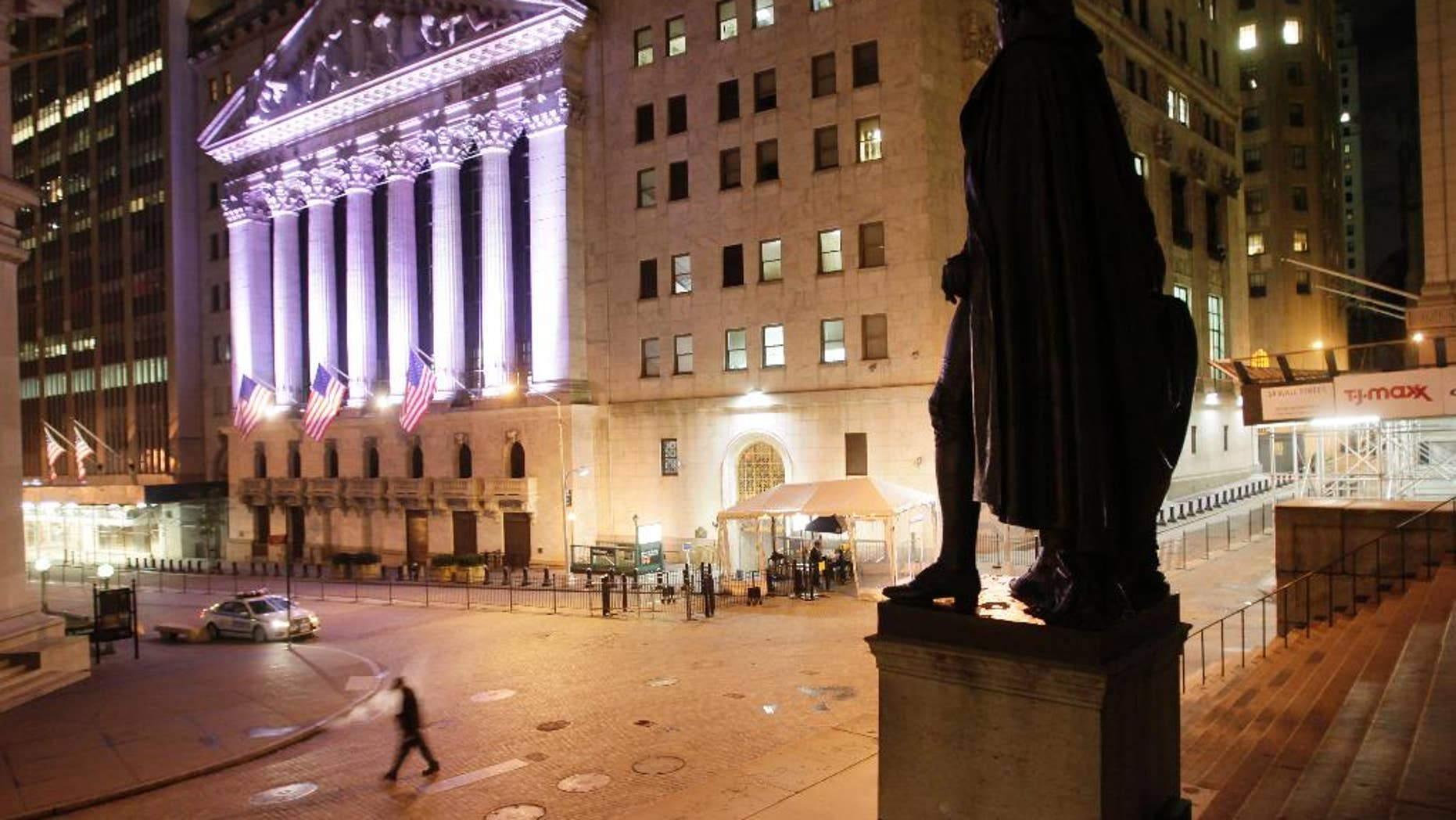 A statue of George Washington stands near The New York Stock Exchange, background, Wednesday, Oct. 8, 2014 in New York. World stock markets mostly retreated Thursday Nov. 6, 2014 as investors awaited a European Central Bank policy meeting and a U.S. jobs report that might deliver a verdict on whether the Federal Reserve's withdrawal of stimulus was warranted. (AP Photo/Mark Lennihan)