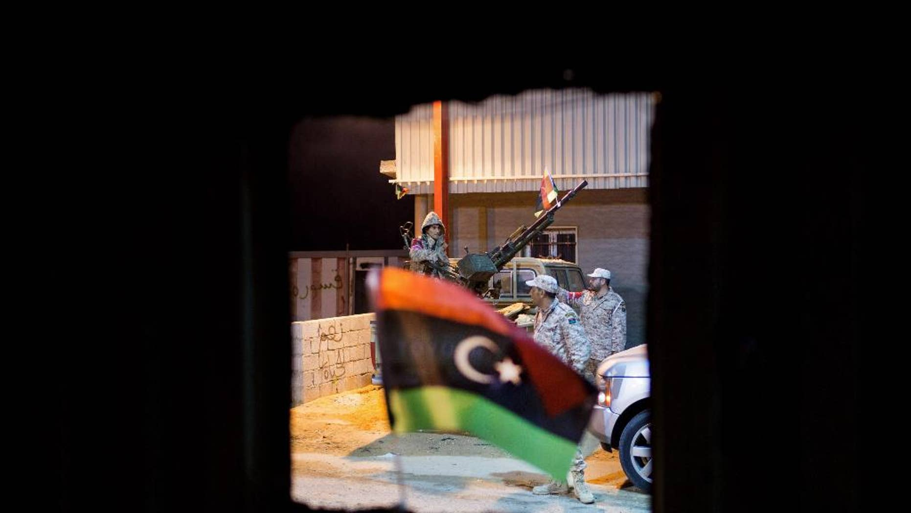 In this Wednesday, Feb. 18, 2015 photo, Libyan military soldiers stand guard, east of the city of Misrata, Libya. (AP Photo/Mohamed Ben Khalifa)