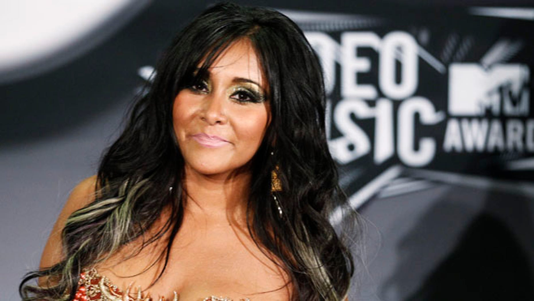"""Aug. 28, 2011: Nicole """"Snooki"""" Polizzi from the MTV reality series """"Jersey Shore"""" poses at the 2011 MTV Video Music Awards in Los Angeles."""