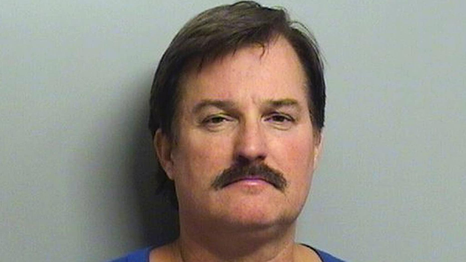 FILE - This undated file booking photo provided by the Tulsa County Sheriff's Office shows Shannon Kepler. On Friday, Nov. 11, 2016, a judge declared a mistrial after jurors couldn't agree whether to convict Kepler, a former Tulsa police officer, of first-degree murder in the 2014 fatal shooting of his daughter's boyfriend. (Tulsa County Sheriff's Office via AP, File)