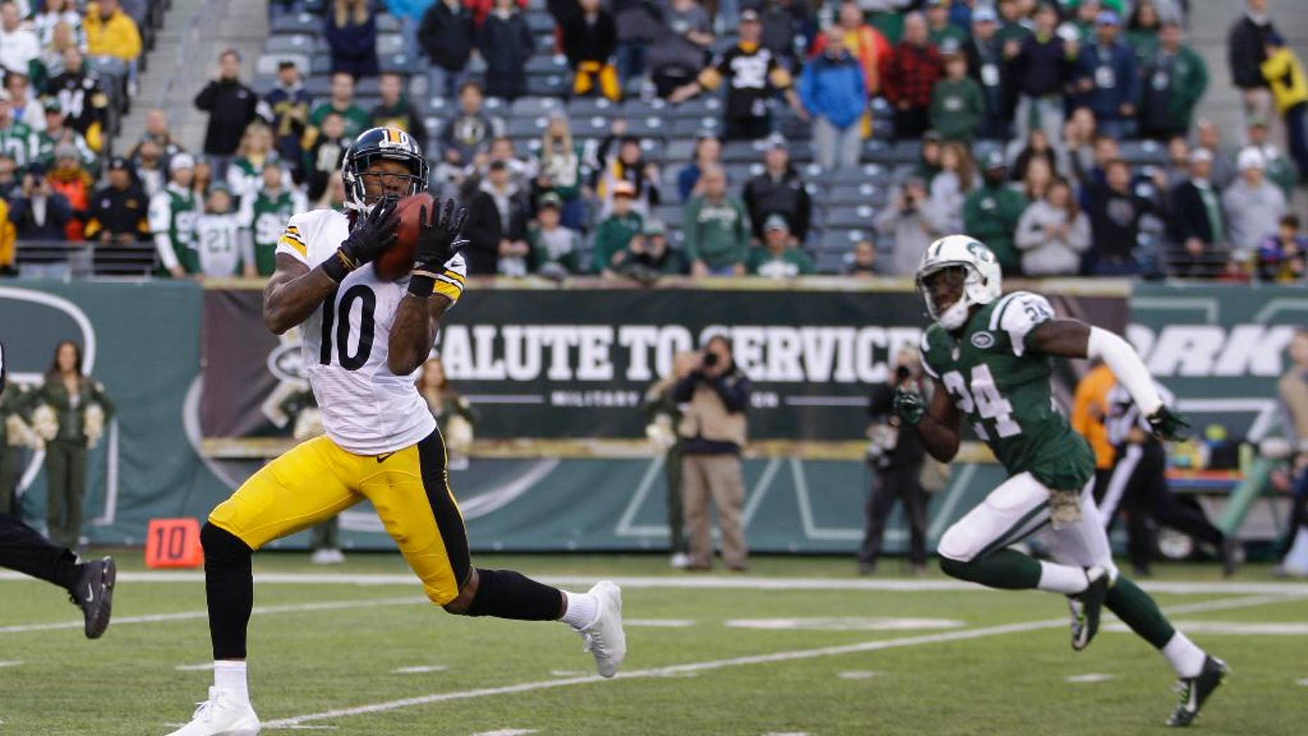 Pittsburgh Steelers wide receiver Martavis Bryant (10) catches a pass for in front of Phillip Adams (24) during the second half of an NFL football game, Sunday, Nov. 9, 2014, in East Rutherford, N.J. Bryant scored a touchdown on the play. (AP Photo/Kathy Willens)