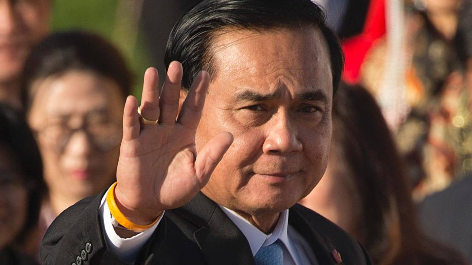 """FILE - In this Saturday, July 16, 2016, file photo, Thailand's Prime Minister Prayuth Chan-ocha waves as he arrives for a group photo of leaders at the 11th Asia-Europe Meeting (ASEM) in Ulaanbaatar, Mongolia. On Wednesday, Prime Minister Prayuth defended the military detention of """"so-called political prisoners,"""" saying they are given good housing and food, but that they sometimes complain about things like the quality of air conditioning. (AP Photo/Mark Schiefelbein, File)"""