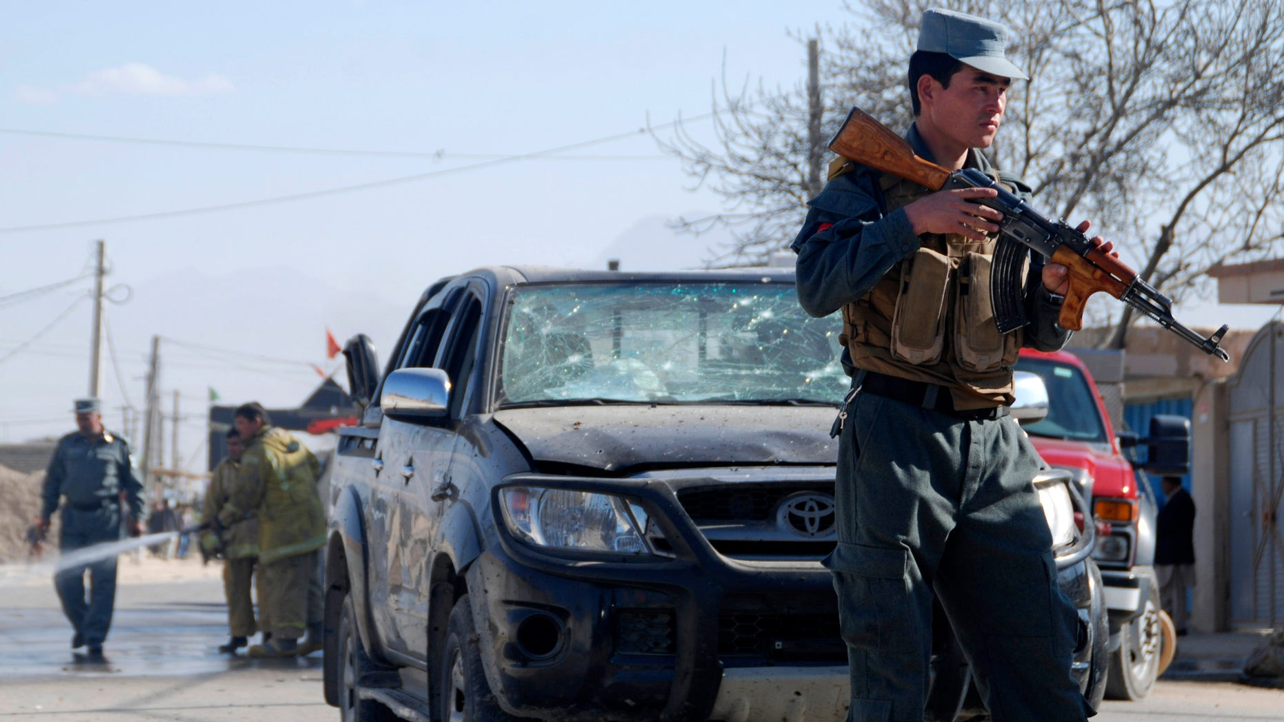 An Afghan policeman secures the area where a suicide bomber attacked the deputy governor of Balkh province in Mazar-e-Sharif, northern Afghanistan, Sunday, Nov. 17, 2013.  While the official escaped unhurt, at least one civilian was killed, said Balkh police spokesman Sher Jan Durrani.  (AP Photo/Mustafa Najafizada)