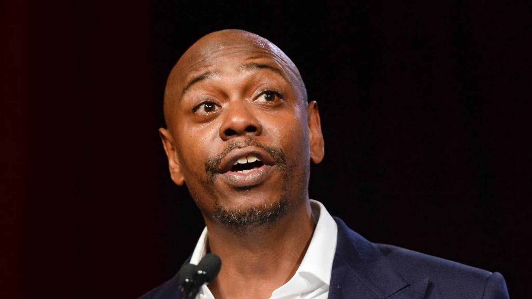 """FILE - In this July 18, 2015 file photo, comedian Dave Chappelle speaks at the RUSH Philanthropic Arts Foundation's Art for Life Benefit in New York. Chappelle is set to host NBC's """"Saturday Night Live"""" on Nov. 12, marking his debut appearance on the show. He will be joined by hip-hop group A Tribe Called Quest. (Photo by Scott Roth/Invision/AP, File)"""