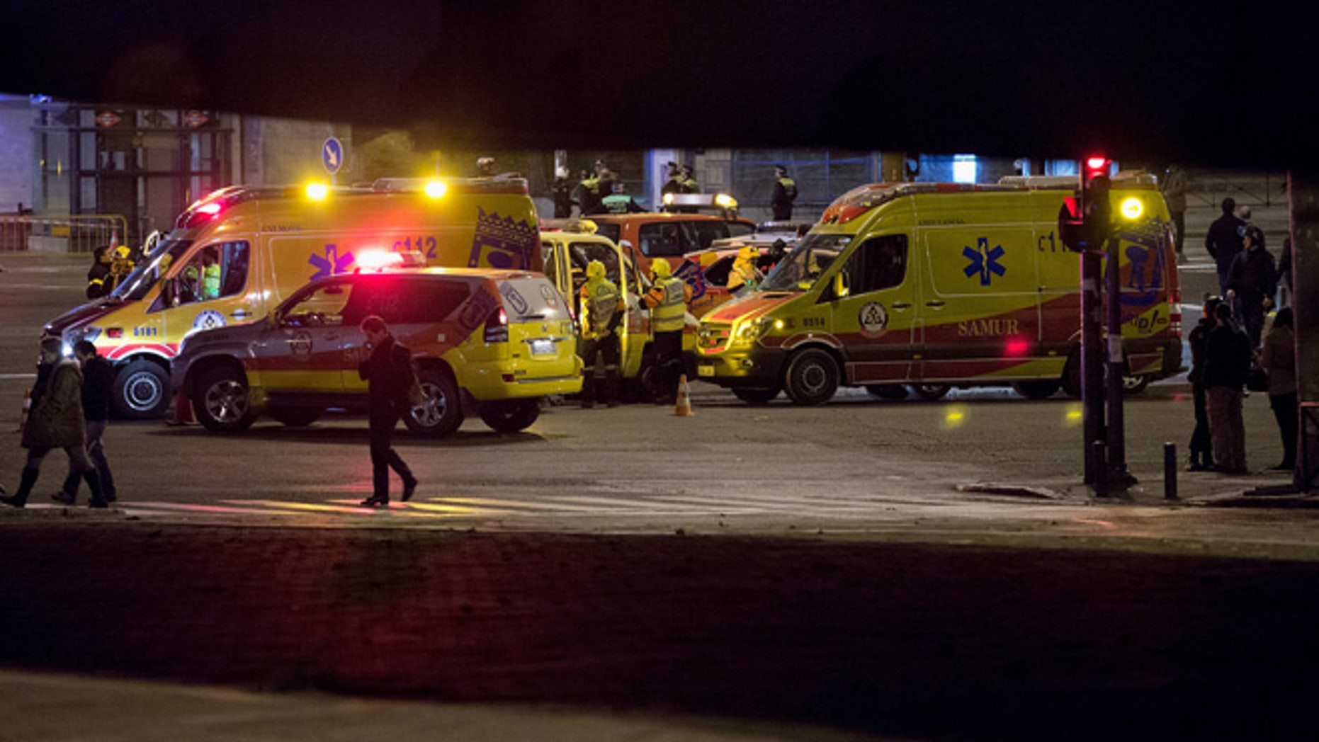 MADRID, SPAIN - JANUARY 08:  Ambulances prepare to leave the area after a suspicious package which was thought to be a bomb was found not to be dangerous at Nuevos Ministerios Train Station on January 8, 2015 in Madrid, Spain. Twelve people were killed yesterday including two police officers, as two gunmen open fire at the offices of the French satirical publication Charlie Hebdo. French Police have made seven arrests in connection with the attack while further violence today included a gunman killing a policewoman in the southern suburb of Montrouge. (Photo by Pablo Blazquez Dominguez/Getty Images)