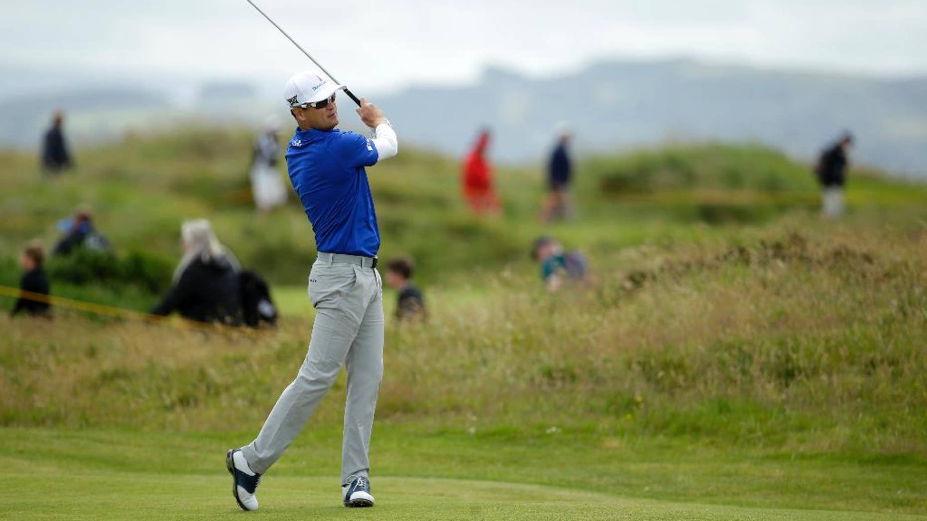 Zach Johnson of the United States plays the 15th fairway during a practice round ahead of the British Open Golf Championship at the Royal Troon Golf Club in Troon, Scotland, Wednesday, July 13, 2016.The British Open starts Thursday. (AP Photo/Matt Dunham)