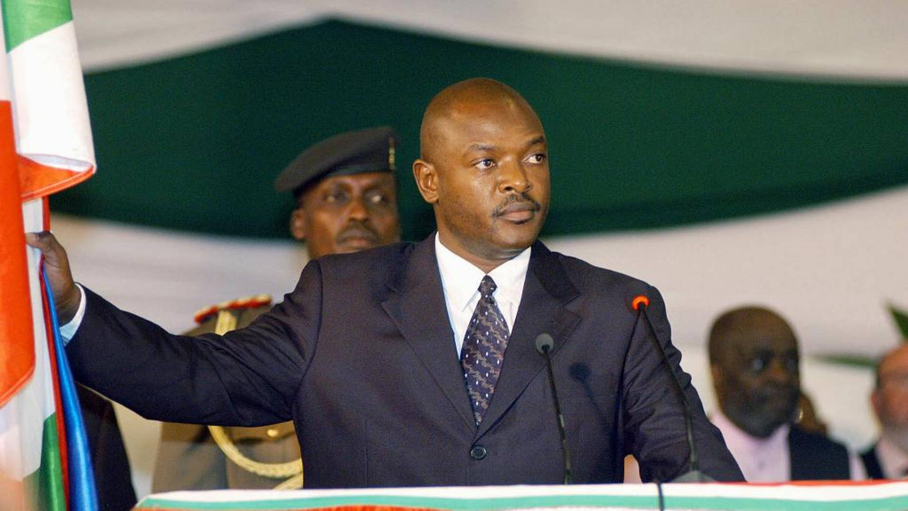 FILE - In this Aug. 26 2005 file photo, Burundi's president, Pierre Nkurunziza stands as he takes the presidential oath in parliament in the capital, Bujumbura, Burundi. Burundi's re-elected president is urging unity after winning contentious polls that the international community says were not credible. In a televised speech on Thursday, July 30, 2015, Pierre Nkurunziza said he would be a president for all, including those who did not vote for him. (AP Photo/Riccardo Gangale, File)