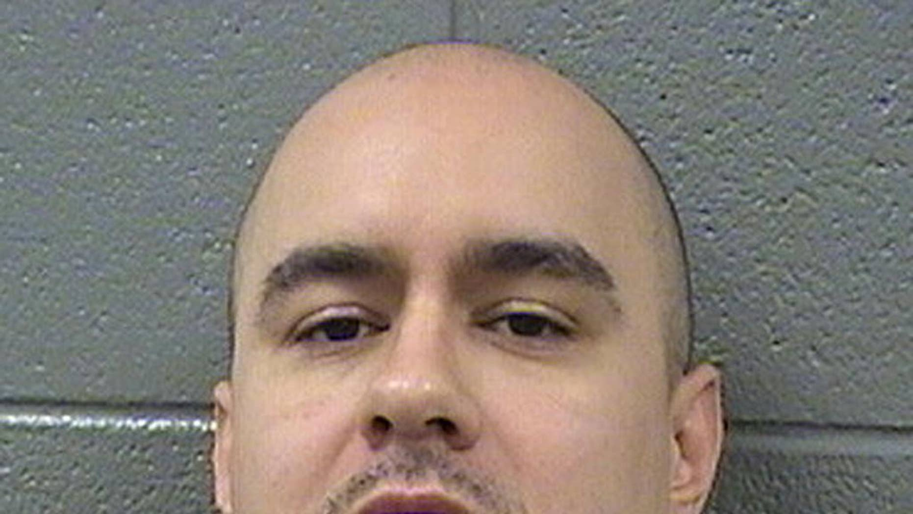 This undated photo provided by the Cook County Sheriff's Department shows Thaddeus Jimenez. Jimenez, who won a $25 million award in 2012 for a wrongful murder conviction only to spend it on rebuilding his Simon City Royals street gang was sentenced to nine years in prison by a federal judge Thursday March. 9, 2017, in Chicago. U.S. District Judge Harry Leinenweber sentenced Jimenez after prosecutors showed a video of Jimenez calmly shooting a former gang member in both legs. (Cook County Sheriff's Department via AP)