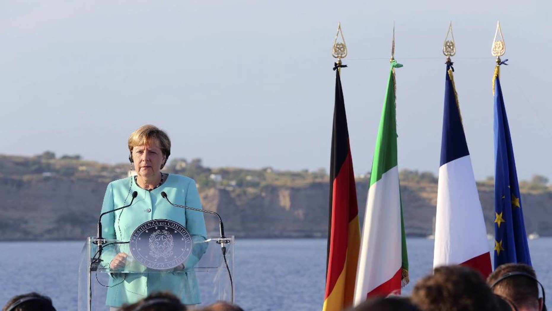 German Chancellor Angela Merkel speaks on the deck of the Italian aircraft carrier Garibaldi off Ventotene island's shores, Italy, Monday, Aug. 22, 2016. The leaders of Italy, France and Germany headed Monday to one of the birthplaces of European unity in a symbolic bid to relaunch the European project following Britain's decision to leave the EU. (AP Photo/Roberta Basile)