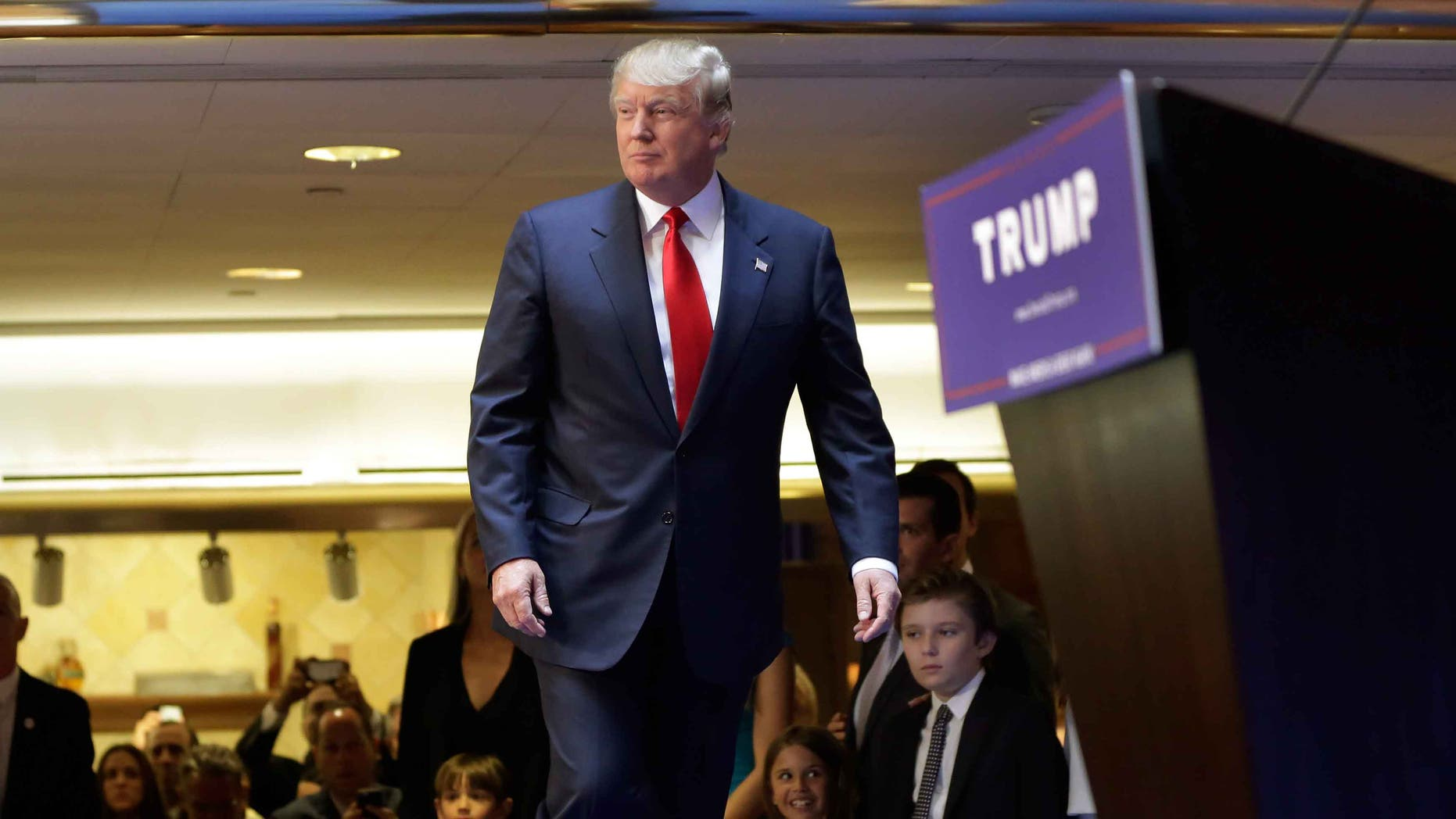Developer Donald Trump takes the stage to announce that he will seek the Republican nomination for president, Tuesday, June 16, 2015, in the lobby of Trump Tower in New York,  Tuesday, June 16, 2015. (AP Photo/Richard Drew)