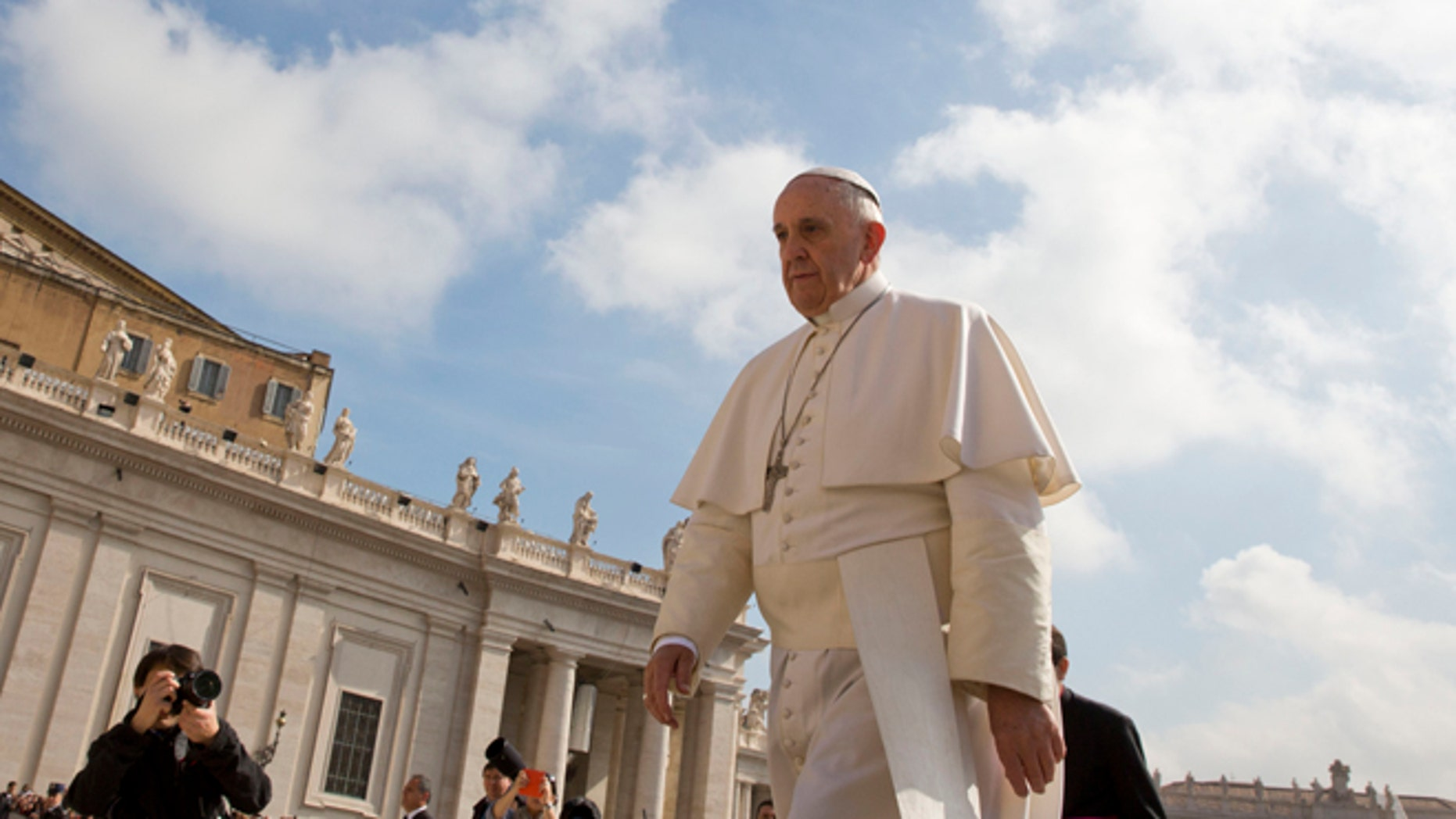 Pope Francis arrives for his weekly general audience in St. Peter's Square at the Vatican, Wednesday, April 29, 2015. (AP Photo/Alessandra Tarantino)