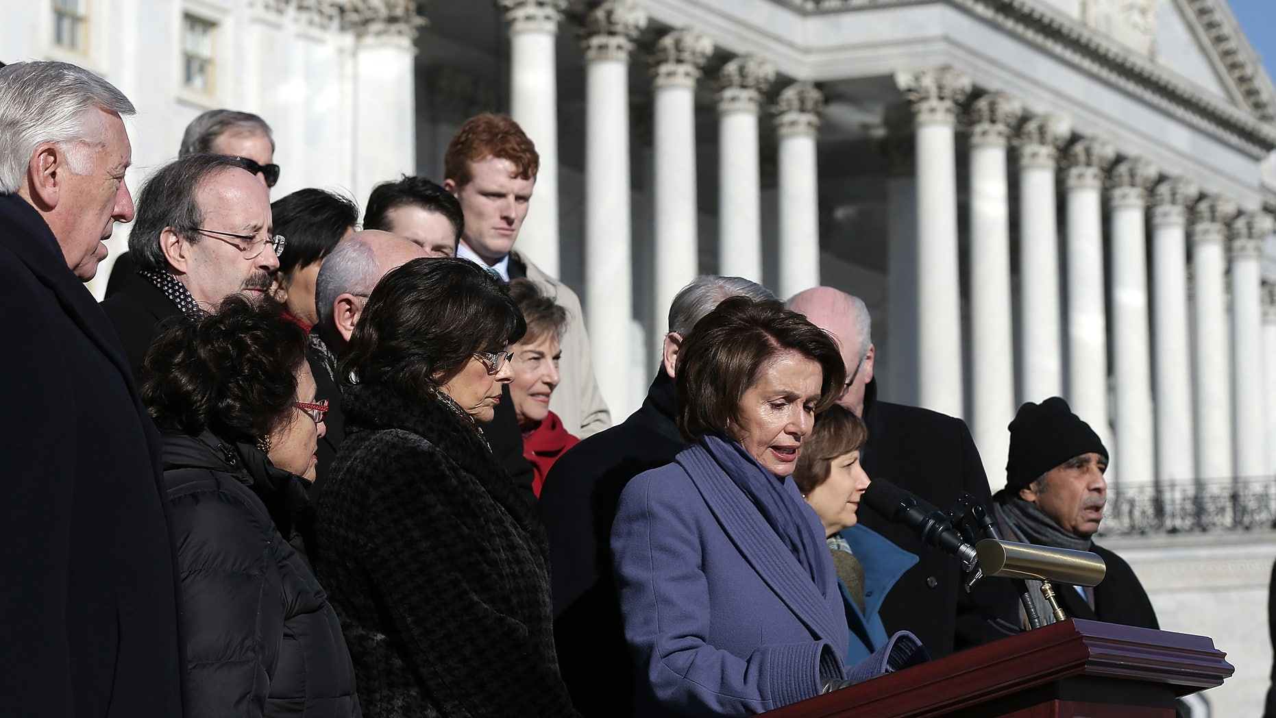 """WASHINGTON, DC - FEBRUARY 13:  House Minority Leader Nancy Pelosi (D-CA), joined by other members of the House Democratic caucus, speaks during a news conference on the steps of the U.S. Capitol February 13, 2015 in Washington, DC. House Democrats held the news conference to call on House Republicans to pass a """"clean"""" funding bill for the Department of Homeland Security. (Photo by Win McNamee/Getty Images)"""