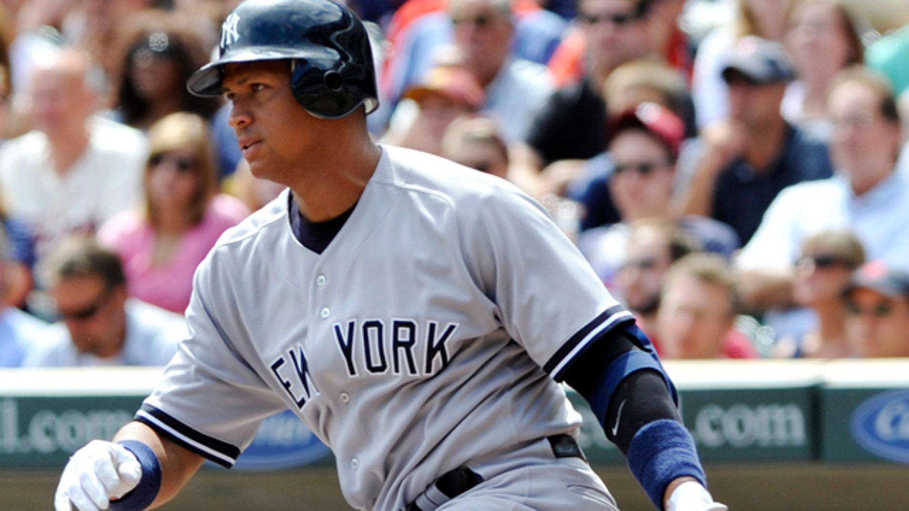Aug 21: Alex Rodríguez bats against the Twins. (AP/Jim Mone)