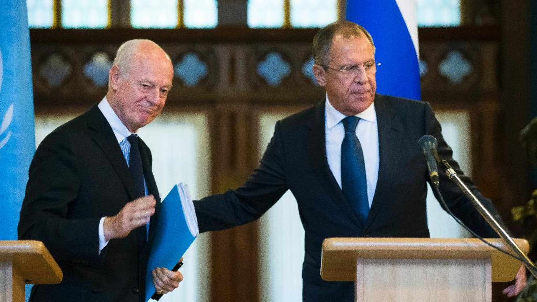 Russian Foreign Minister Sergey Lavrov, right, and U.N. Special Envoy for Syria Staffan de Mistura leave a news conference following their talks in Moscow, Russia, Wednesday, Nov. 4, 2015. Lavrov says he hopes that international peacebrokers in the coming days will agree on the list of opposition groups that should be invited to peace talks. (AP Photo/Alexander Zemlianichenko)