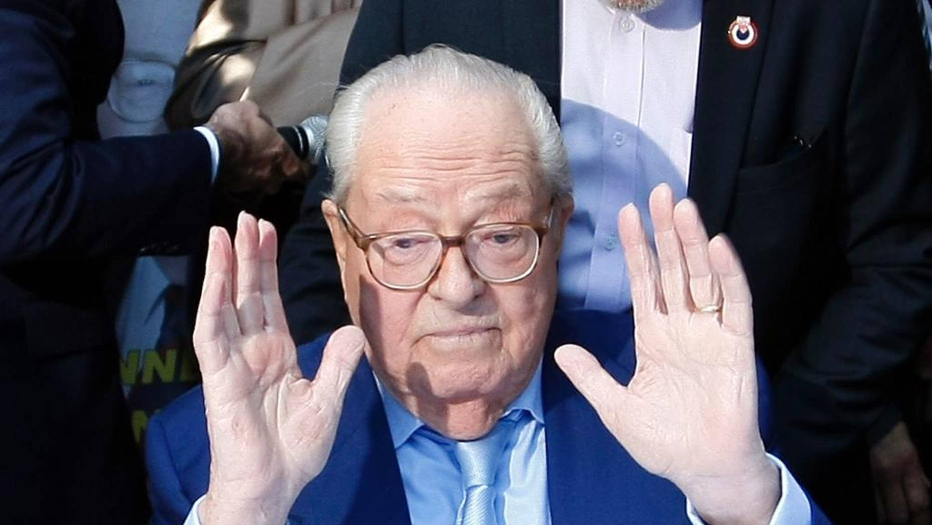 FILE - In this Sept. 5, 2015 file photo, Jean-Marie le Pen, former head of the far-right party National Front, gestures after a press conference in Marseille, southern France. Jean-Marie Le Pen on Wednesday OCT. 5, 2016 asked a court to force the party he founded to let him back in, after he was expelled for anti-Semitic comments that embarrassed his daughter Marine as she pursues the French presidency. (AP Photo/Claude Paris, File)