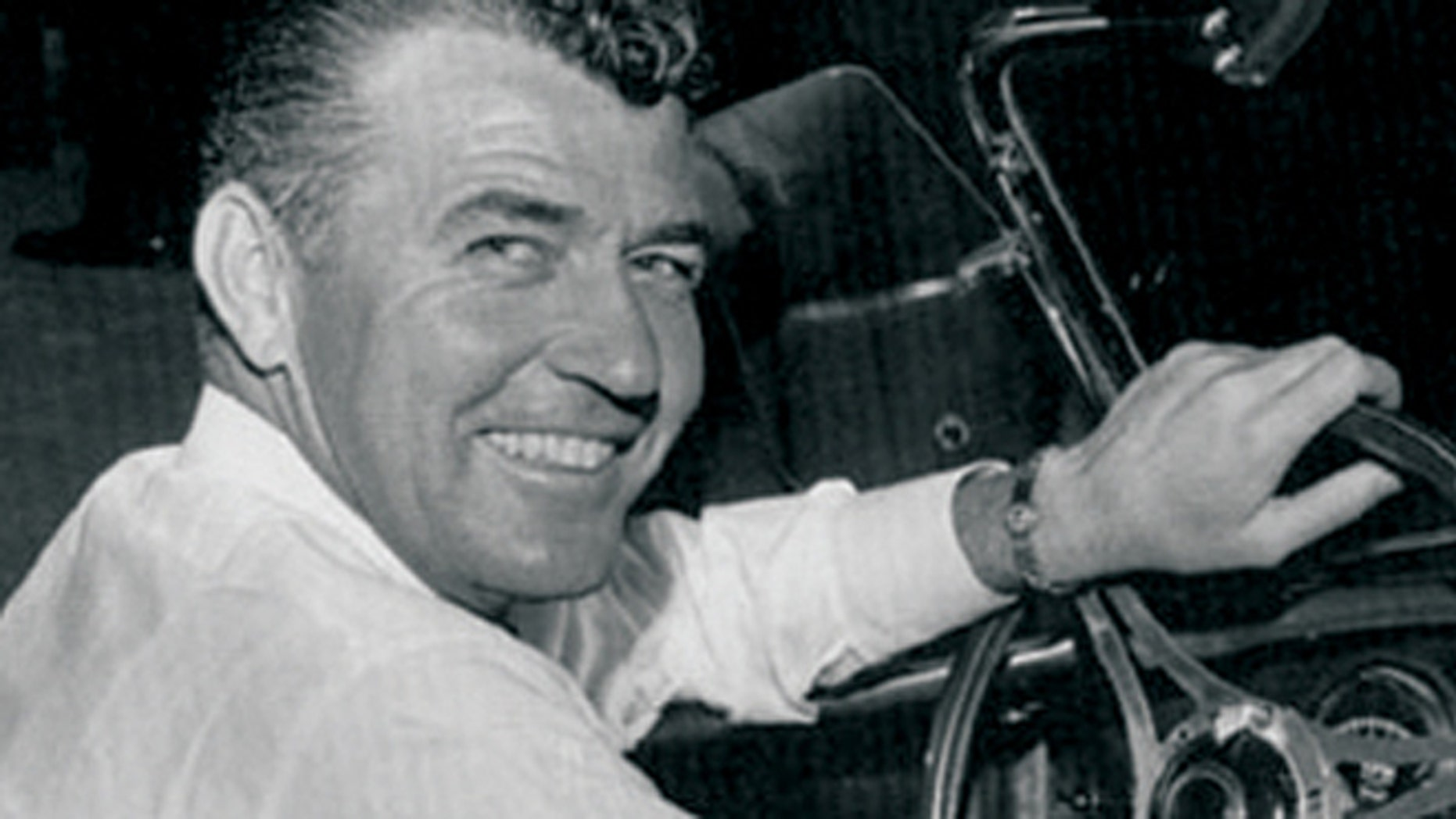 Carroll Shelby at the wheel of the original Shelby Cobra