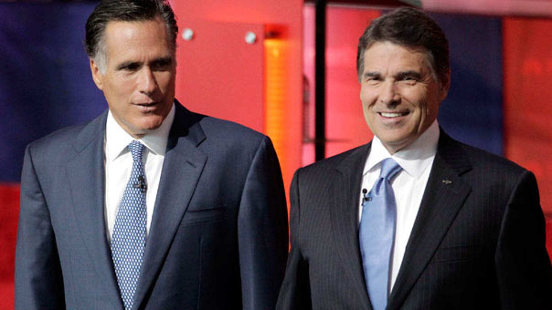 Spet. 7: Republican presidential candidates former Massachusetts Gov. Mitt Romney, left, and Texas Gov. Rick Perry, stand together before a Republican presidential candidate debate at the Reagan Library in Simi Valley, Calif.