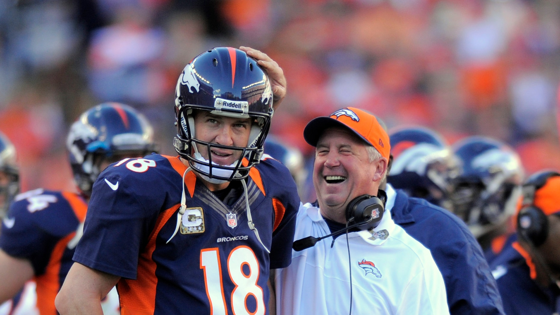 FILE - In this Nov. 17, 2012, file photo, Denver Broncos quarterback Peyton Manning (18) looks on as head coach John Fox celebrates during an NFL football game between the Denver Broncos and the San Diego Chargers in Denver. The Broncos have reeled off nine consecutive wins after a 2-3 start. (AP Photo/Jack Dempsey, File)