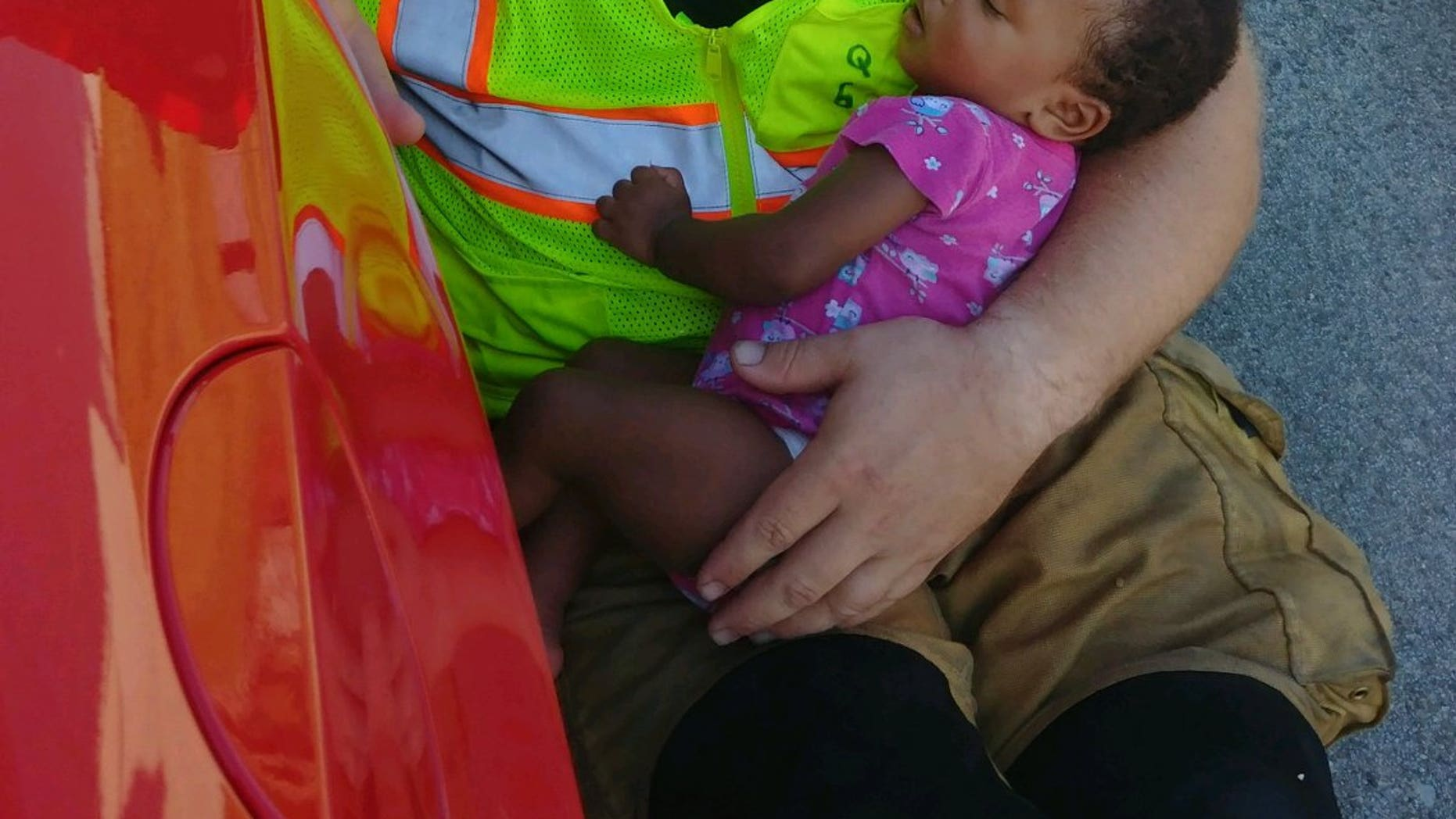 A photo of Capt. Chris Blazek, of the Chattanooga Fire Department, cradling a baby after she was in a car accident on State Route 58 has gone viral since the department posted it to Facebook Monday.